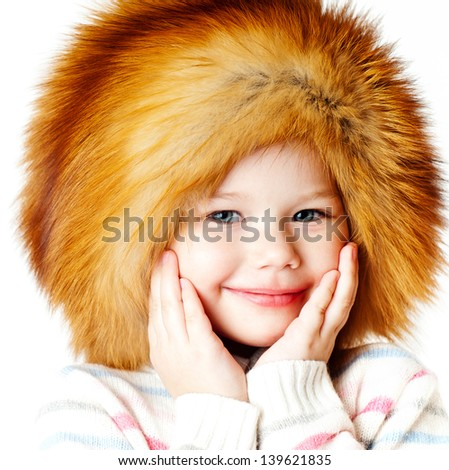 cheerful girl in a fur hat - stock photo
