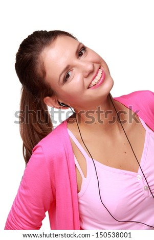 Cheerful girl in bright clothes and headphones listening to music and having fun - stock photo