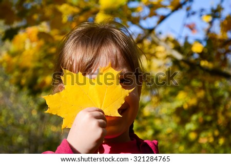 Cheerful girl  in fall park - stock photo