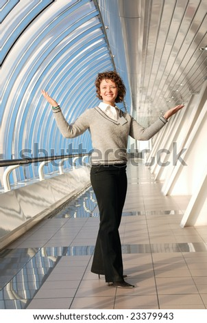 Cheerful girl in modern office - stock photo