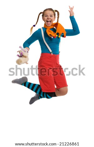cheerful girl in multi-coloured clothes jumps isolated on white