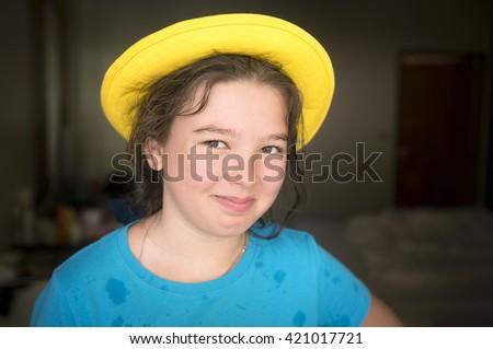 Cheerful girl in yellow cap - stock photo