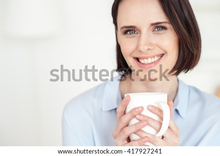 Cheerful girl is resting at home - stock photo