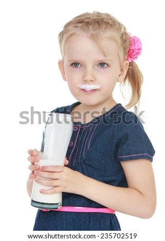 cheerful girl jokingly smeared lips yogurt which she drinks from a large glass beaker.White background, isolated photo. - stock photo