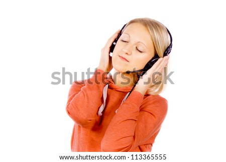 Cheerful girl listening to the music isolated on white background - stock photo