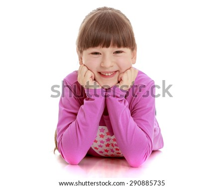Cheerful girl lying on the floor smiling - isolated on white background - stock photo