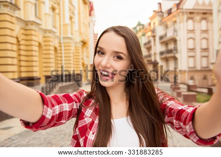 cheerful girl making selfe photo and showing her tongue - stock photo