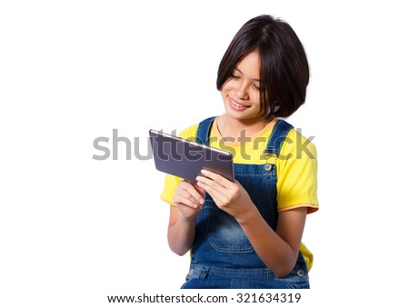 cheerful girl playing tablet with isolated background - stock photo
