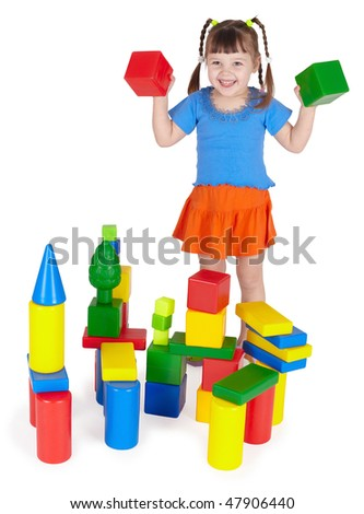 Cheerful girl playing with colored blocks on white - stock photo