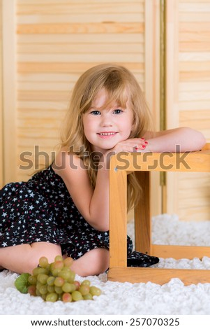 cheerful girl plays with her room - stock photo