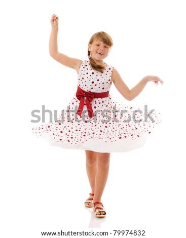 Cheerful girl spinning on floor isolated on white - stock photo