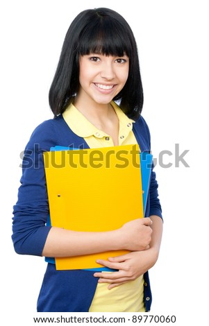 Cheerful girl student on a white background - stock photo