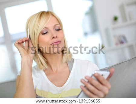 Cheerful girl using smartphone - stock photo