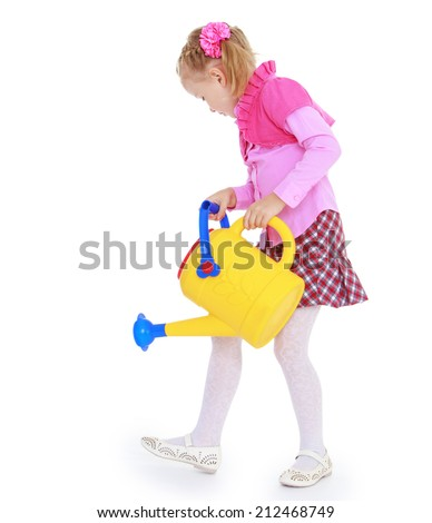 cheerful girl watering the garden of yellow watering can on a white background.The concept of child development, education, recreation - stock photo