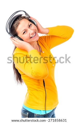 cheerful girl with a beautiful smile in headphones - stock photo