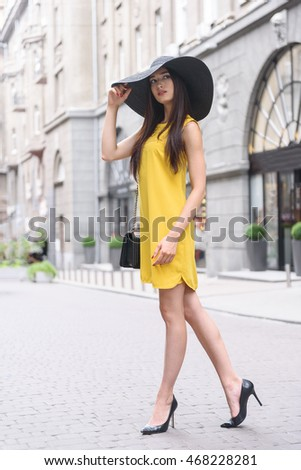 Cheerful girl with fashionable sunhat