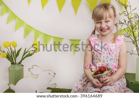 cheerful girl with flowers in spring, Easter