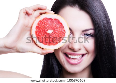 cheerful girl with grapefruit on white background