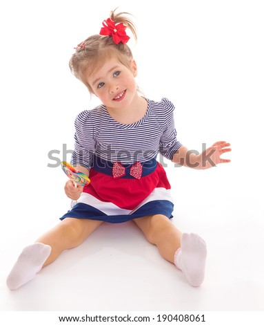 Cheerful girl with Lollipop in his hands on a white background - stock photo