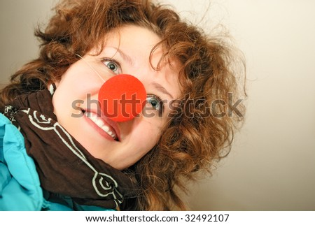 Cheerful girl with red nose - stock photo