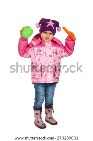 cheerful girl with toy vegetables.  Isolation on a white background - stock photo