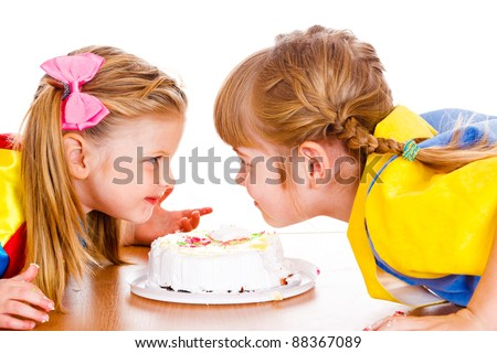 Cheerful girls with creamy fingers looking at one another - stock photo