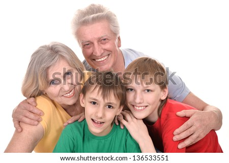 cheerful grandparents and their two grandchildren in colored T-shirts