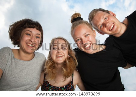 Cheerful group of students outdoors - stock photo