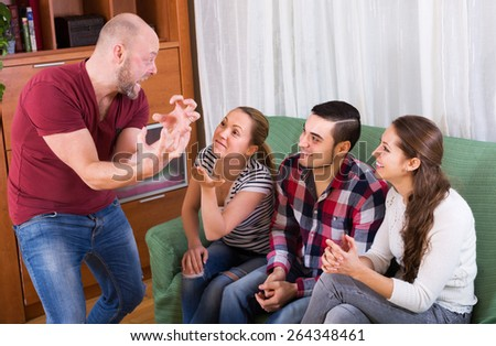 Cheerful group of young adults having fun at house booze party - stock photo