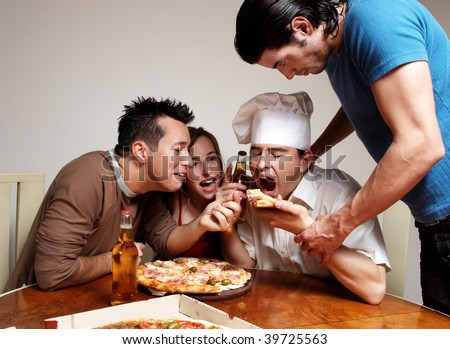 Cheerful group of youth in a pizza - stock photo