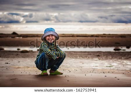 Cheerful haired girl on the beach. - stock photo