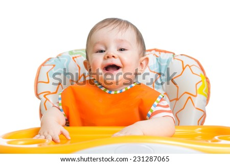 cheerful happy baby child waiting for food - stock photo