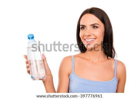 Cheerful happy brunette holding a bottle with fresh water - stock photo