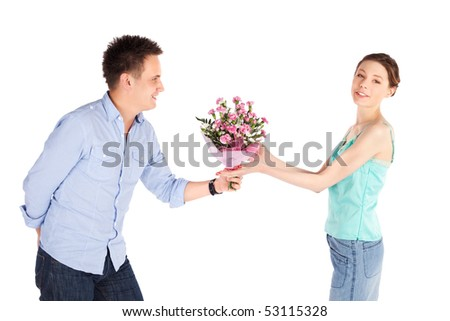 Cheerful happy casual couple isolated on white, romantic man giving flowers to his girlfriend - stock photo