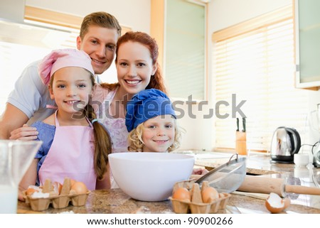 Cheerful happy family preparing dough