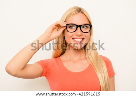 Cheerful happy smiling blonde in red shirt and glasses - stock photo