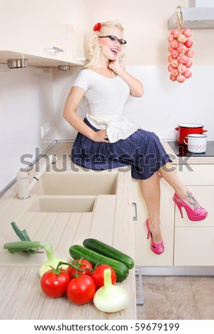 Cheerful housewife in the kitchen, similar available in my portfolio - stock photo