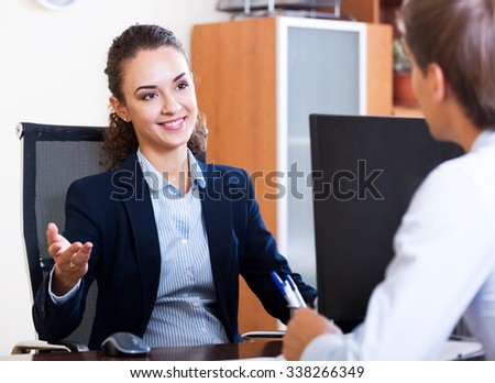 Cheerful hr manager inreviewing competitor for avalible vacancy - stock photo