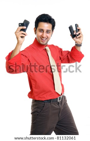 Cheerful Indian businessman with variety cell pones - stock photo