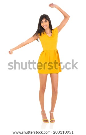 cheerful indian girl dancing on plain background - stock photo