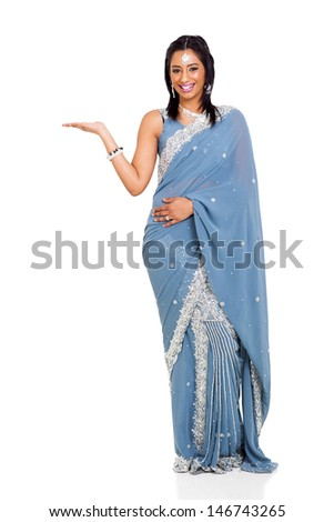cheerful indian woman wearing sari presenting isolated on white - stock photo