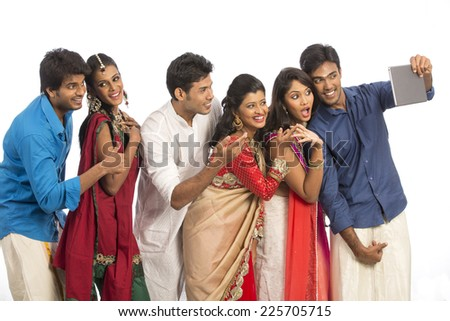 Cheerful Indian young different culture family taking selfie on white background.  - stock photo