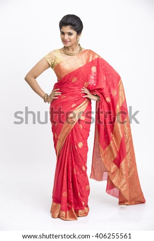Cheerful indian young girl posing in traditional Indian saree on white background - stock photo