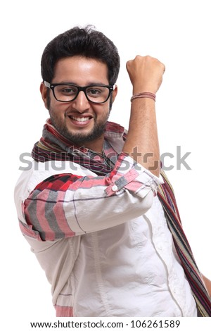Cheerful indian young man posing to the camera. - stock photo