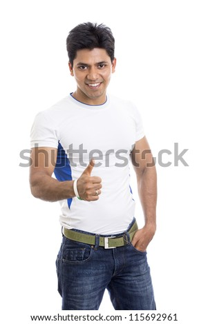 Cheerful Indian young man showing thumbs up sign on white. - stock photo