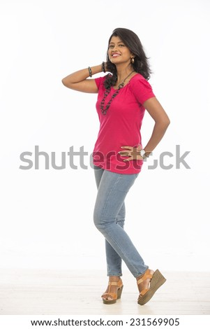 cheerful Indian young women in casual on white  - stock photo