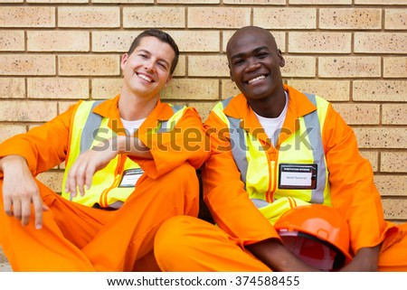 cheerful industrial electrical technician relaxing during break - stock photo