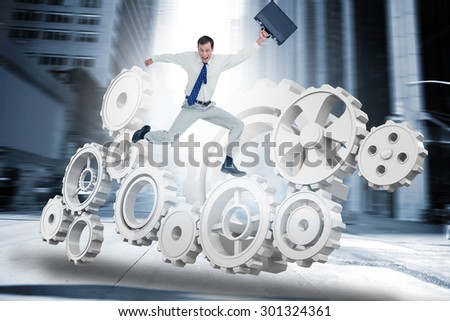 Cheerful jumping businessman with his suitcase against new york street - stock photo