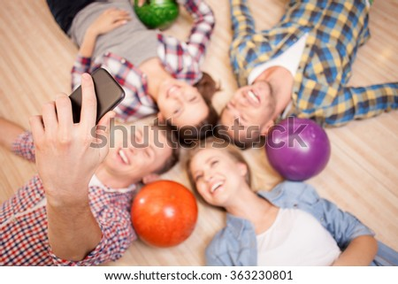 Cheerful kegling team is resting after game - stock photo