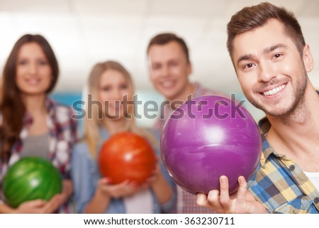 Cheerful kegling team is spending time together - stock photo